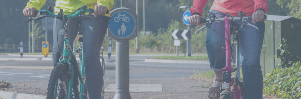 Two cyclists on a shared use cycling/walking path